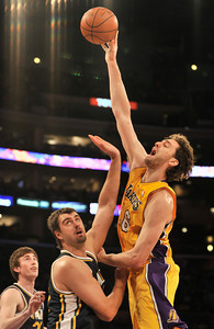 Pau Gasol shoots over Mehmet Okur. The Lakers hosted the Utah Jazz in a game played at Staples Center in Los Angeles ,CA 1-25-2011. (John McCoy/staff photographer)