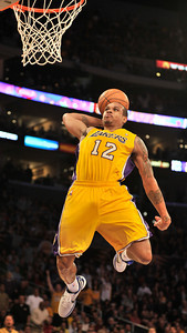 Shannon Brown flies to the hoop for a missed dunk attempt in the 4th quarter. The Lakers defeated the Utah Jazz 120 to 91 in a game played at Staples Center in Los Angeles ,CA 1-25-2011. (John McCoy/staff photographer)