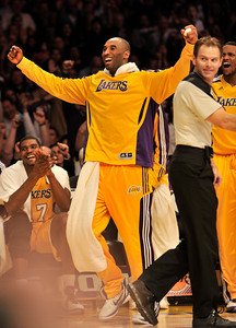 Kobe Bryant cheers for Lamar Odom after he made an off balance shot while flying out of bounds in the 4th quarter. The Lakers defeated the Utah Jazz 120 to 91 in a game played at Staples Center in Los Angeles ,CA 1-25-2011. (John McCoy/staff photographer)