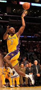 Lamar Odom makes a difficult off balance basket before flying out of bounds in the 4th quarter. The Lakers defeated the Utah Jazz 120 to 91 in a game played at Staples Center in Los Angeles ,CA 1-25-2011. (John McCoy/staff photographer)