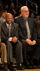 Brian Shaw and Phil Jackson enjoy the final minutes as the Lakers defeat the Utah Jazz 120 to 91 in a game played at Staples Center in Los Angeles ,CA 1-25-2011. (John McCoy/staff photographer)
