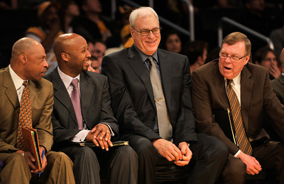The Laker coaches seem to be enjoying garbage time as the Lakers defeate the Utah Jazz 120 to 91 in a game played at Staples Center in Los Angeles ,CA 1-25-2011. (John McCoy/staff photographer)