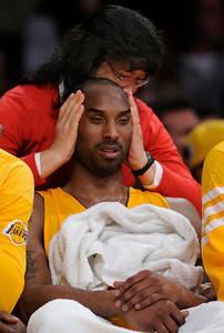 Julie Seto, team physical therapist, assists Los Angeles Lakers guard Kobe Bryant (24) in the 4th quarter. The Lakers defeated the Minnesota Timberwolves 104 to 85 in a game played at the Staples Center in Los Angeles, CA 2/29/2012(John McCoy/Staff Photographer)