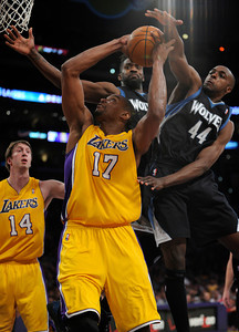 Los Angeles Lakers center Andrew Bynum (17) is fouled by Minnesota Timberwolves power forward Anthony Tolliver (44) in the first half. The Lakers played host to the Minnesota Timberwolves in a game played at the Staples Center in Los Angeles, CA 2/29/2012(John McCoy/Staff Photographer)