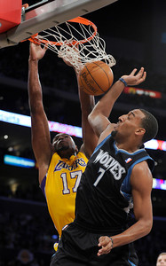 Los Angeles Lakers center Andrew Bynum (17) dunks the ball over Minnesota Timberwolves forward Derrick Williams (7) in the first half. The Lakers played host to the Minnesota Timberwolves in a game played at the Staples Center in Los Angeles, CA 2/29/2012(John McCoy/Staff Photographer)