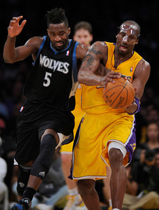 Minnesota Timberwolves small forward Martell Webster (5) and Los Angeles Lakers shooting guard Kobe Bryant (24) scrap for the ball. The Lakers defeated the Minnesota Timberwolves 104 to 85 in a game played at the Staples Center in Los Angeles, CA 2/29/2012(John McCoy/Staff Photographer)