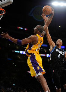 Los Angeles Lakers shooting guard Kobe Bryant (24) goes up for a dunk against Minnesota Timberwolves shooting guard Wesley Johnson (4) in the first half. The Lakers played host to the Minnesota Timberwolves in a game played at the Staples Center in Los Angeles, CA 2/29/2012(John McCoy/Staff Photographer)