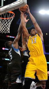 Minnesota Timberwolves small forward Martell Webster (5) gets in the way of an attempted dunk by Los Angeles Lakers center Andrew Bynum (17) in the first half. The Lakers played host to the Minnesota Timberwolves in a game played at the Staples Center in Los Angeles, CA 2/29/2012(John McCoy/Staff Photographer)