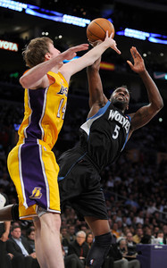 Los Angeles Lakers power forward Troy Murphy (14) fouls Los Angeles Lakers point guard Steve Blake (5) in the 4th quarter. The Lakers defeated the Minnesota Timberwolves 104 to 85 in a game played at the Staples Center in Los Angeles, CA 2/29/2012(John McCoy/Staff Photographer)