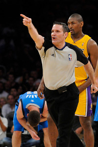 The official throws Ron Artest out of the game for a flagrant foul against Jose Barea. The Lakers  were defeated 93-81 by the Dallas Mavericks in game 2 of the playoffs. Los Angeles, CA 5-4-2011. (John McCoy/staff photographer)