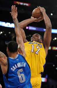 Andrew Bynum gets a shot off over Tyson Chandler in the 2nd quarter. The Lakers played host to the Dallas Mavericks in game 2 of the playoffs. Los Angeles, CA 5-4-2011. (John McCoy/staff photographer)
