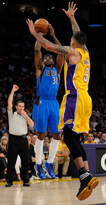 Jason Terry shoots over Matt Barnes. The Lakers  were defeated 93-81 by the Dallas Mavericks in game 2 of the playoffs. Los Angeles, CA 5-4-2011. (John McCoy/staff photographer)