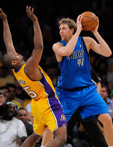 Ron Artest and Dirk Nowitzki battle in the first half. The Lakers played host to the Dallas Mavericks in game 2 of the playoffs. Los Angeles, CA 5-4-2011. (John McCoy/staff photographer)