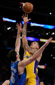 Matt Barnes shoots over Peja Stojakovic. The Lakers played host to the Dallas Mavericks in game 2 of the playoffs. Los Angeles, CA 5-4-2011. (John McCoy/staff photographer)