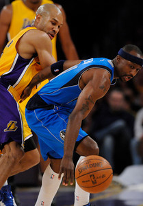 Derek Fisher and Jason Terry keep an eye on a ball that Fisher knocked loose in the first half. The Lakers played host to the Dallas Mavericks in game 2 of the playoffs. Los Angeles, CA 5-4-2011. (John McCoy/staff photographer)