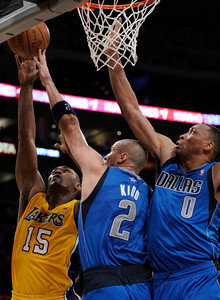 Ron Artest goes to the hoop against Jason Kidd and Shawn Marion in the 2nd quarter. The Lakers played host to the Dallas Mavericks in game 2 of the playoffs. Los Angeles, CA 5-4-2011. (John McCoy/staff photographer)