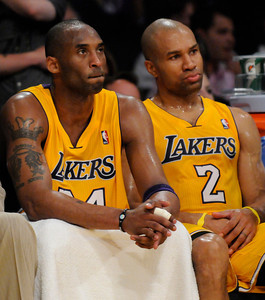 Kobe Bryant and Derek Fisher watch the final seconds tick off the clock. The Lakers  were defeated 93-81 by the Dallas Mavericks in game 2 of the playoffs. Los Angeles, CA 5-4-2011. (John McCoy/staff photographer)