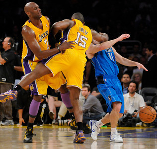 Lamar Odom watches as Ron Artest makes a flagrant foul on Jose Barea and is ejected from the game. The Lakers  were defeated 93-81 by the Dallas Mavericks in game 2 of the playoffs. Los Angeles, CA 5-4-2011. (John McCoy/staff photographer)