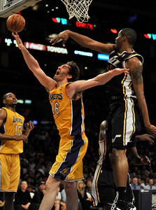 Pau Gasol is blocked by Jazz #15 Derrick Favors. The Lakers lost to the Utah Jazz 86-85 in a game played at Staples Center in Los Angeles, CA 4-5-2011. (John McCoy/staff photographer)