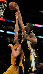 Lakers Pau Gasol has a shot blocked by Jazz Al Jefferson. The Lakers lost to the Utah Jazz 86-85 in a game played at Staples Center in Los Angeles, CA 4-5-2011. (John McCoy/staff photographer)