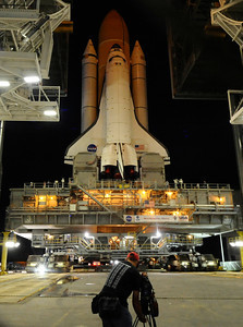 Space shuttle Atlantis rolls out for it's final space shuttle rollout to launch pad tonight. While space shuttle Endeavour completes her final orbits of the planet tonight, sister ship Atlantis is traveling to Kennedy Space Center's launch pad 39A. Rollout got underway at about 8:43 p.m. EDT. Kennedy Space Center FL.   May 31,2011. photo by Gene Blevins/LA Daily News