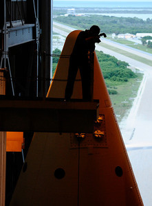 Space shuttle workers get some last minute photos of Atlantis sets ready for it's final space shuttle rollout to launch pad tonight. While space shuttle Endeavour completes her final orbits of the planet tonight, sistership Atlantis is traveling to Kennedy Space Center's launch pad 39A. Rollout got underway at about 8:43 p.m. EDT. Kennedy Space Center FL.   May 31,2011. photo by Gene Blevins/LA Daily News
