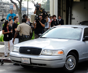 """Lindsay Lohan arrives as she begins her jail sentence for a probation violation at the Beverly Hills courthouse Tuesday morning. A judge determined two weeks ago that the """"Mean Girls"""" star violated her probation by missing seven alcohol education classes since December. Beverly Hills CA, July 20, 2010. Photo by Gene Blevins/LA DailyNews"""