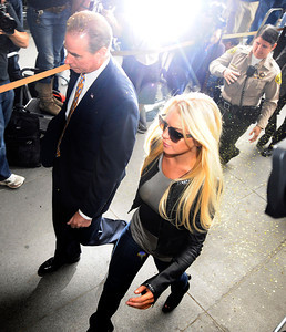 """The actress surrendered at a Beverly Hills courthouse Tuesday morning. A judge determined two weeks ago that the """"Mean Girls"""" star violated her probation by missing seven alcohol education classes since December. Beverly Hills CA, July 20, 2010"""