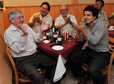 (l-r) Pancho Cid, German Suarez, Roberto Niquet, and Matias Pizarro cheer the action on the TV. Members of the Chilean community gathered at Rincon Chileno Restaurant to watch their countrymen on television who were trapped in a mine for 69 days. They sat in the restaurant drinking wine, eating and celebrating as the miners were rescued.  Hollywood, CA. 10-12-2010. (John McCoy/staff photographer)