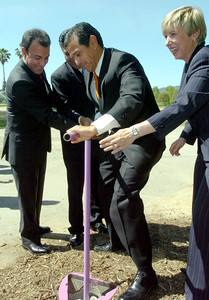 Mayor Antonio Villaraigosa gets help to turn on the water sprinklers  at Woodley Lakes Golf Course  in Van Nuys, Ca., using recycled water on left is DWP's President, David Nahai, Los Angeles City Council Tony Cardenas and Wendy Gruel on Wednesday, June 6, 2007.  (Tina Burch/Staff Photographer)