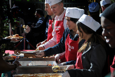 (l-r) Sheriff Lee Baca, David Dreier, BooBoo Steward and his sister Fivel Stewart serve up meals. The Los Angeles Mission held its annual Christmas event to feed and provide gifts to the less fortunate. Chef Ben Ford whipped up a holiday meal with the help of celebrities that included Gilles Marini, Sarah Drew and teen heartthrob BooBoo Stewart from the film Twilight-Breaking Dawn. After receiving a meal, Children were escorted to a tent where they had a visit with Santa and received gifts. Nearly 4000 people were expected to receive charity at the event.Los Angeles, CA 12/23/2011(John McCoy/Staff Photographer)