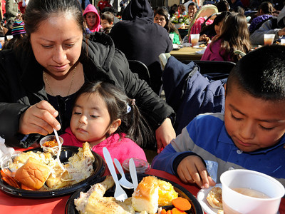 (l-r) Maria Angeles and her daughter Michelle and son Richard partake in the free meal. The Los Angeles Mission held its annual Christmas event to feed and provide gifts to the less fortunate. Chef Ben Ford whipped up a holiday meal with the help of celebrities that included Gilles Marini, Sarah Drew and teen heartthrob BooBoo Stewart from the film Twilight-Breaking Dawn. After receiving a meal, Children were escorted to a tent where they had a visit with Santa and received gifts. Nearly 4000 people were expected to receive charity at the event.Los Angeles, CA 12/23/2011(John McCoy/Staff Photographer)