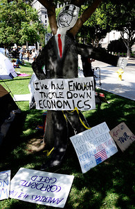 Several dozen protesters who blame the economic meltdown on greedy corporations, set up tents over the weekend on sidewalks by Los Angeles City Hall. No arrests have been made, and police say the demonstrators can stay unless they cause problems. The protester LA have gathered in support and  sympathy for the 700 Wall Street protesters who were arrested in New York over the weekend. Los Angeles CA.  Oct 3,2011. Photo by Gene Blevins/LA Daily News