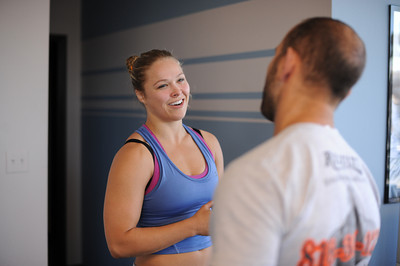 Ronda Rousey talks to trainer Chris Frincu while conditioning at Results Studio in Studio City, CA. (Hans Gutknecht/Staff Photographer)