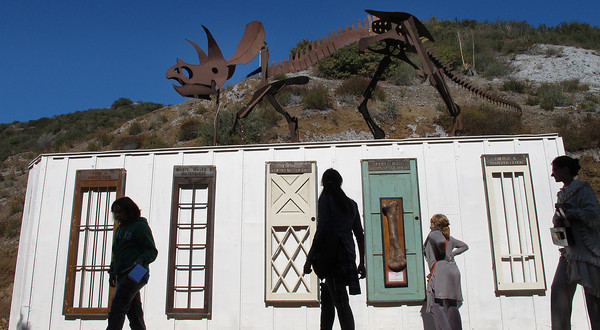 """A repurposed storage container called the """"Wunderklammer"""" will be used as a working lab.  A dinosaur sculpture is erected on top. Suzy Amis Cameron and Zev Yaroslavsky, LA County Supervisor,  cut the ribbon on the brand new MUSE School in Calabasas Highlands, Monday, November 11, 2011.   (Dean Musgrove/Staff Photographer)"""