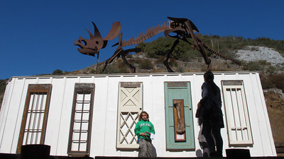 """Lara, a fourth grade student, leads a tour of the campus.  A repurposed storage container called the """"Wunderklammer"""" will be used as a working lab.  A dinosaur sculpture is erected on top. Suzy Amis Cameron and Zev Yaroslavsky, LA County Supervisor,  cut the ribbon on the brand new MUSE School in Calabasas Highlands, Monday, November 11, 2011.   (Dean Musgrove/Staff Photographer)"""