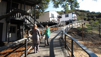 Lara, a fourth grade student, leads a tour of the muse campus. Suzy Amis Cameron and Zev Yaroslavsky, LA County Supervisor,  cut the ribbon on the brand new MUSE School in Calabasas Highlands, Monday, November 11, 2011.   (Dean Musgrove/Staff Photographer)