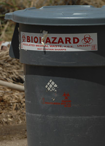 The deaths of a man and a woman were reported in a house located at 20410 Lassen Avenue in Chatsworth. Police were called to the home during the early morning hours on Saturday. Biohazard material was placed into this bin by a technician who was working behind the house.  Chatsworth, CA. 8-13-2011. (John McCoy/Staff Photographer)