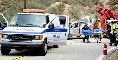 Los Angeles county coroner van arrives at the scene to transport the body that was found in another car were David Lavau's  car had plunged 200 feet off a remote mountain road, was found on Thursday, Sept. 29, 2011 by his three adult children, who had enlisted the help of a missing persons detective. Lavau suffered multiple rib fractures, a broken arm and multiple fractures in his back. While he was being rescued, another vehicle was found nearby, its driver dead. Authorities don't know if that vehicle was involved in a collision with Lavau's car, or if it was a separate accident. CASTAIC CA  Sept 30,2011. Photo by Gene Blevins/LA Daily News