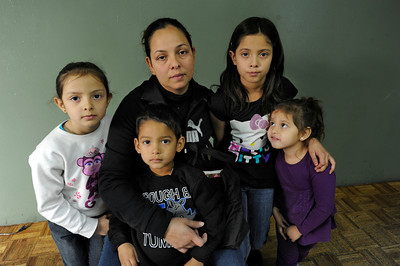 Maria Gonzales and her children (l-r) Catherine Parra,6, Eric Parra,3, Leslie Parra,10, and Zayra Parra,3. Missing from the photo is Heriberto Parra, 36 of San Fernando, who had been working to immigrate to the United States for many years with the help of a Notary Public, who he believed had the legal ability to help him gain citizenship. Recently he was detained, and will face deportation because he has not taken the necessary legal steps.  The mother of his children, and while not married his defacto spouse Maria Gonzales, held a press conference to ask that her family be reunited, and Parra allowed to continue his quest for citizenship. Van Nuys, CA 1/6/2012(John McCoy/Staff Photographer)