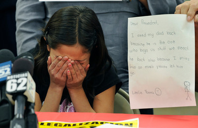 Leslie Parra,10, cries while sitting next to a letter she wrote that asks for the return of her father, Heriberto Parra, 36 of San Fernando. Parra, had been working to immigrate to the United States for many years with the help of a Notary Public, who he believed had the legal ability to help him gain citizenship. Recently he was detained, and will face deportation because he has not taken the necessary legal steps.  The mother of his children, and while not married his defacto spouse Maria Gonzales, held a press conference to ask that her family be reunited, and Parra allowed to continue his quest for citizenship. Van Nuys, CA 1/6/2012(John McCoy/Staff Photographer)
