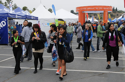 Participants in the Los Angeles Marathon arrived at 10AM Friday morning at Dodger Stadium to get their bib numbers, and check out a variety of sponsor tents where running merchandise was being sold. Los Angeles, CA 3/16/2012(John McCoy/Staff Photographer)
