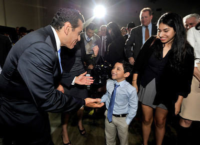 Mayor Antonio Villaraigosa sees his grandson Andres Antonio Silva, 5, after his State of the City Address at Thomas Jefferson High School in Los Angeles, CA 4-13-2011. (John McCoy/staff photographer)