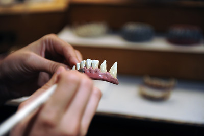 Mask Supervisor Jenn Rose paints teeth for a wolfman mask during a media preview for  Universal Studios' ÒHalloween Horror NightsÓ at  the Globe Theatre venue at Universal Studios Hollywood Wednesday, September 7, 2011. (Hans Gutknecht/Staff Photographer)
