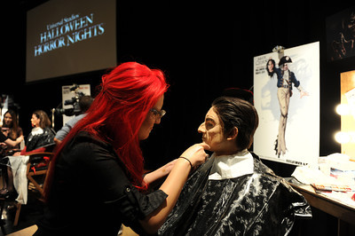 Makeup artist Lisette Santana makes Aaron Eiermann in to Executioner Alice from Alice Cooper's Welcome to My Nightmareduring a media preview for  Universal Studios' ÒHalloween Horror NightsÓ at  the Globe Theatre venue at Universal Studios Hollywood Wednesday, September 7, 2011. (Hans Gutknecht/Staff Photographer)