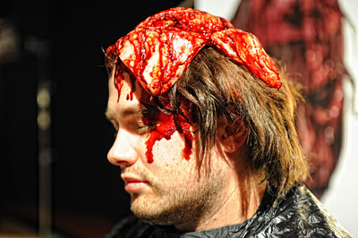 Makeup artist Stacy Smith turns Justin Delk in to Scalped Jerry from Rob ZombieÕs House of 1000 Corpsesduring a media preview for  Universal Studios' ÒHalloween Horror NightsÓ at  the Globe Theatre venue at Universal Studios Hollywood Wednesday, September 7, 2011. (Hans Gutknecht/Staff Photographer)