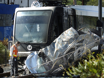 The Metro Gold Line commuter train in Highland Park collided with one car driven by a woman who survived the crash and started a fire early Friday morning, Sept. 21, 2007.  She went through the crossing gate.  (Tina Burch/Staff Photographer)