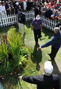 Officials point out the ball that Phil Mickelson hit into a fower garden next to a sponsors tent on the 8th fairway. Phil would go on to hit the ball onto the green, and make par on the hole during the third round of the Northern Trust Open. Pacific Palisades, CA 2/18/2012(John McCoy/Staff Photographer)