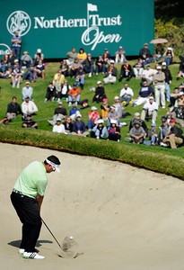 Pat Perez hits out of the bunker onto the 2nd green. He would make par on the hole, and finish 6 under par for the day during the third round of the Northern Trust Open. Pacific Palisades, CA 2/18/2012(John McCoy/Staff Photographer)