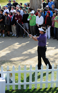 Phil Mickelson had some problems on 8, and ended up taking a drop after landing behind a flower garden next to a sponsors tent during the third round of the Northern Trust Open. Phil went on to hit the ball onto the green and make par. Pacific Palisades, CA 2/18/2012(John McCoy/Staff Photographer)